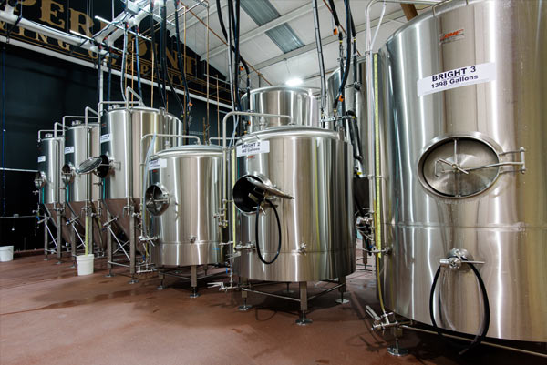 Stainless steel beer tanks in the brewery at Copperpoint Brewing Company